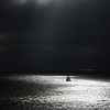 Gloom ~<br /> <br /> Sailboat finding light under stormy skies<br /> <br /> <br /> Redondo Beach, CA.