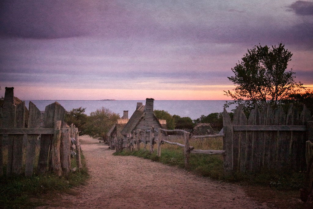 Life in Plymouth Colony: Towards Plymouth Bay down Leyden Street from the Fort at Sunrise, 1627 English Village, Plimoth Plantation, Plymouth, Massachusetts