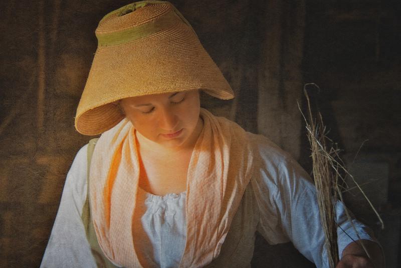 Costumed Female Interpreter Heckling Flax. Philipsburg Manor, Sleepy Hollow, North Tarrytown, Westchester County, New York