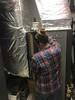 Catie installing an air filter.