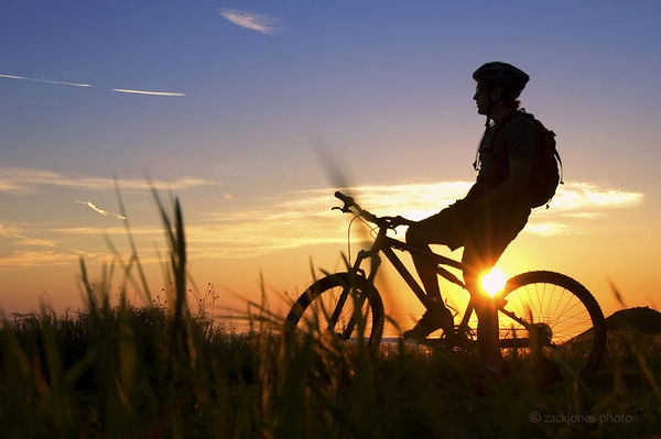 Rick Margolin taking in a Pacific Coast sunset at the end of a ride. Santa Barbara, CA. 2005
