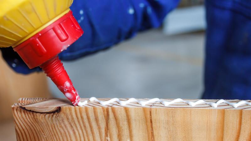 Carpenter at work glueing