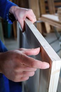 Carpenter at work measuring