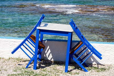 Blue painted chairs and table