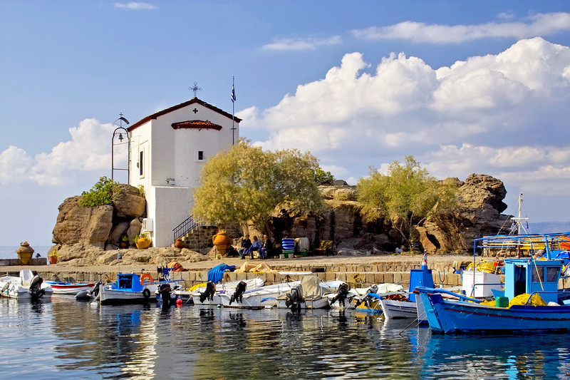 Chapel on rocks in the port of Skala Sykamineas