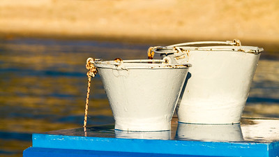 White buckets on blue table