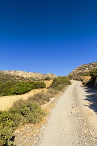 14411593 - dirt track winding through the wilderness on the island of crete