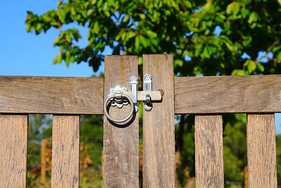 Closed latched wooden gate