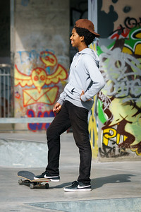 Laughing young skateboarder