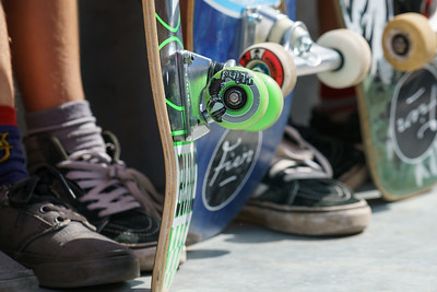 DORDRECHT, NETHERLANDS - 3 SEPTEMBER 2016: Close-up of skateboard wheels and feet as teens hang out at the official opening of the new skateboard park in Dordrecht.
