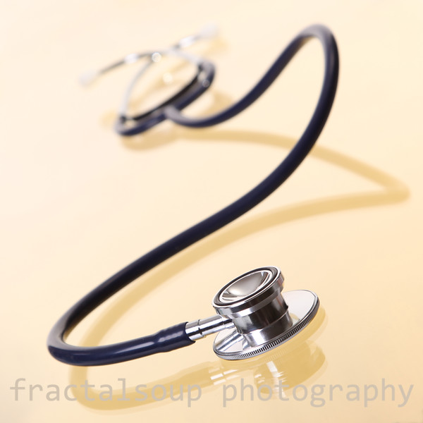 Stethoscope on Gold with Reflection