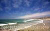 Sandy Beach with Aqua Green Waves Breaking