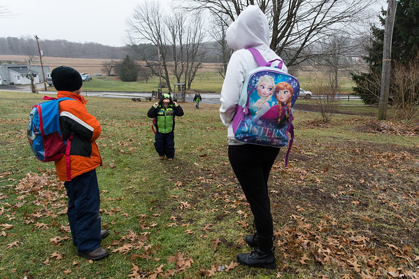 12/2/16, Ulysses, Pa. Sabrina greets 3 of her 7 children after being dropped off by the bus after school.