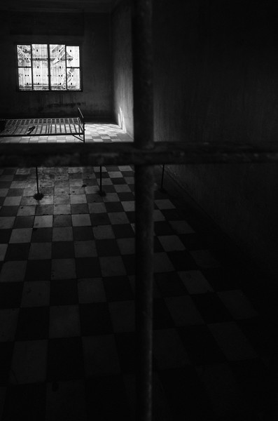 """S-21, Tuol Sleng. Cambodia.<br /> <br /> Film.<br /> <br /> The most notorious of the 189 known interrogation centers in Cambodia was S-21, housed in a former school and now called Tuol Sleng for the hill on which it stands. Between 14,000 and 17,000 prisoners were detained there, often in primitive brick cells built in former classrooms. Only 12 prisoners are believed to have survived.<br /> <br /> S-21 confined mostly """"elite"""" prisoners from the Khmer Rouge's own ranks."""