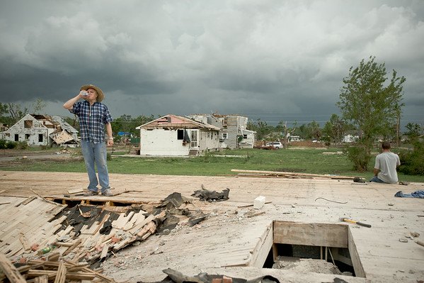 Two residents take a break during clean up efforts in Chapman, Kansas.