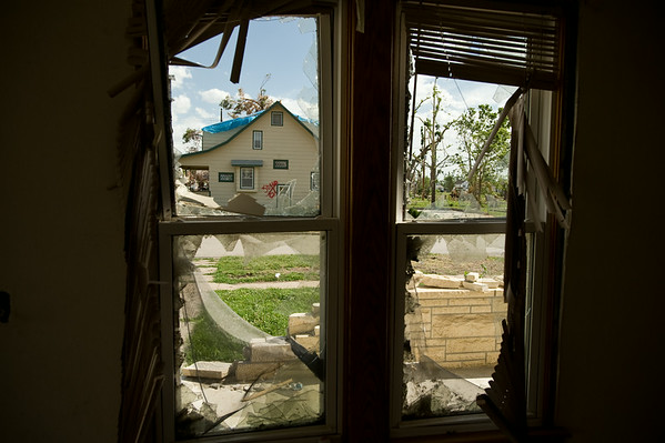 The view from inside a damaged home waiting to be knocked down.