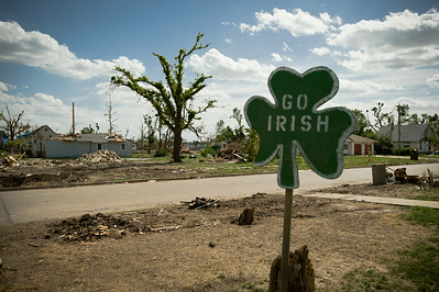 On the night of June 11th, at 10:20pm, a category F-3 tornado at least a half-mile wide devastated the small town of Chapman, Kansas. It left one person dead and created an estimated $70 million in damages. Nearly 70 homes, including the town's two churches, a funeral home, the elementary, middle and high schools were reduced to rubble. Another 215 homes were damaged as a result of the twister. This set of images was taken three weeks after the storm hit. A sign supporting the Fighting Irish of Chapman High School is posted on a residential street in Chapman, Kansas.