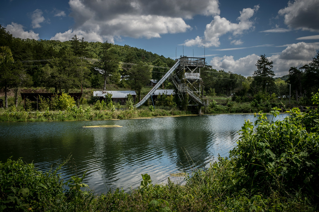 The Rampage Water Slide stands over the trout farm which Dogpatch USA was conceived and developed. The overstocked trout farm had been in operation for 30 years as a small scale tourist attraction before the amusement park was built.