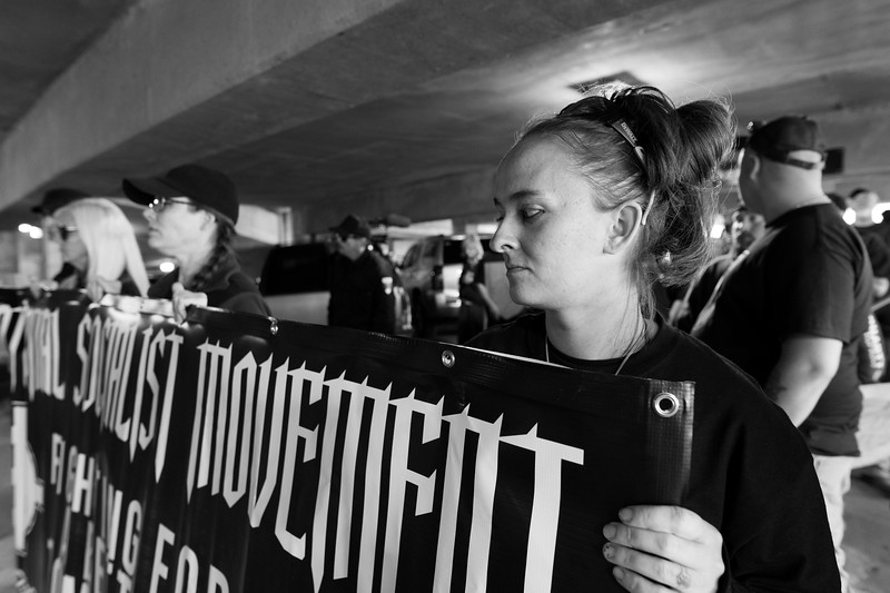 Sabrina holding her part of a white nationalist banner moments prior to a march to the Harrisburg, PA courthouse.