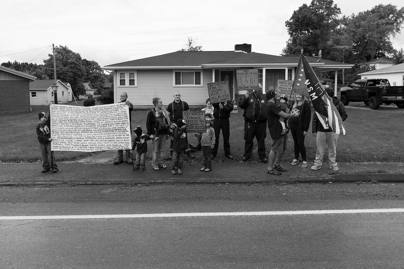 10/8/16. In opposition to a silent protest hosted by Dan, several members of the community hold a counter protest across the street with signs that reference the importance of equality and evils of racism.