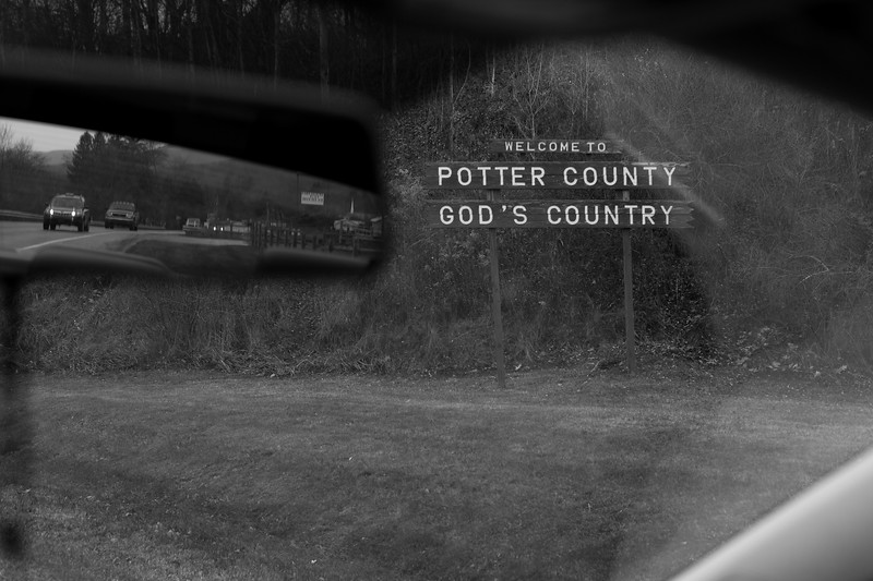 "Welcome sign as you enter Potter County, Pennsylvania. <br /> <br /> In the early 1990's, Potter County was home to an Aryan Nations leader named August Kreis III who found it's vast pinelands, coined ""God's Country"", and it's majority white population to be the perfect setting for a base of operations. <br /> <br /> In 1993, approximately 350 Nazi and racist skinheads attended Aryan Summerfest, a hard-core white supremacist ""hate rock"" festival that August Kreis III hosted at his semi-rural ""Last Outpost,"" consisting of three trailers, a woodshop and a shooting range on 10.4 acres in Potter County, Pennsylvania.<br /> <br /> Later, Kreis hosted the 2002 Aryan Nations World Congress, an agglomeration of skinheads, Klansmen, Nazis and white power bands. Kreis played a key role in spreading white supremacy in Potter County and advocated the mass murder of Jews, non-whites and race traitors until 2009 when he moved from Potter County,  to Lexington, South Carolina."