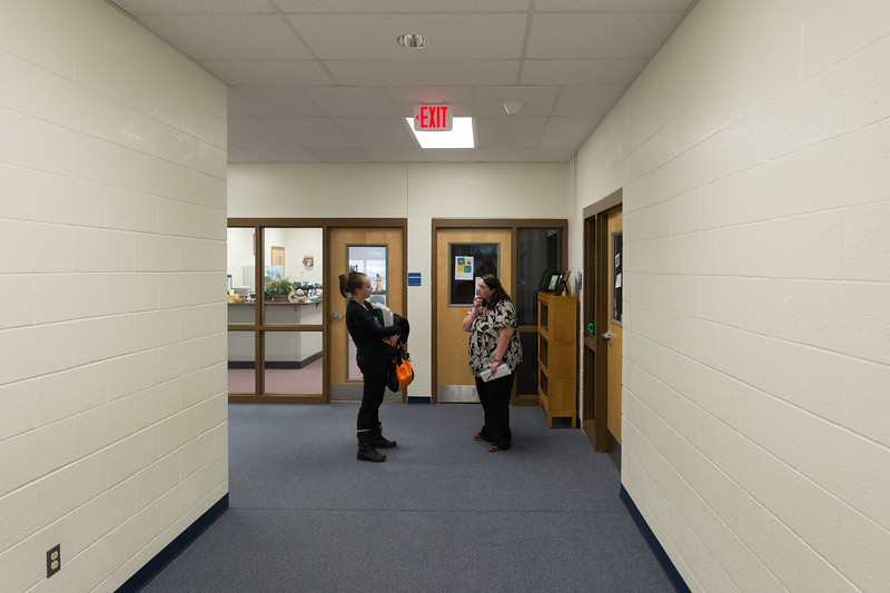 Sabrina finishes up with a teacher following a parent teacher conference.