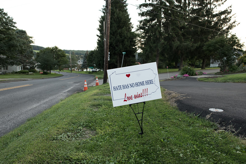 "8/18/2018. Area residents respond to Dan's Nazi ideology by posting over 150 yard signs with the words ""Hate Has No Home Here, Love Wins"" across the small community."