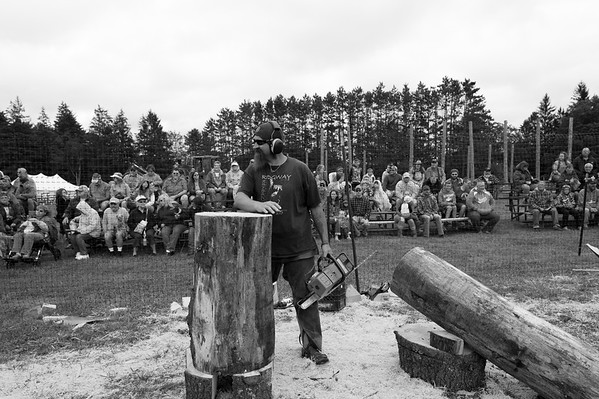 Dan waits for the whistle during a quick carve chainsaw competition at an annual woodsman show. I was told a member of the committee has been trying to ban Daniel from the annual event due to his outspoken beliefs, but the chairman says as long as he's in office Dan has nothing to worry about.