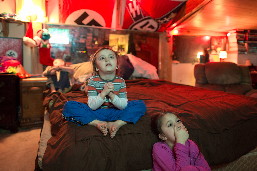 2/18/2017. PA. USA. Danzig (left), Alayrya and Dreysen (background left) watching the cartoon South Park in their parent's bedroom.