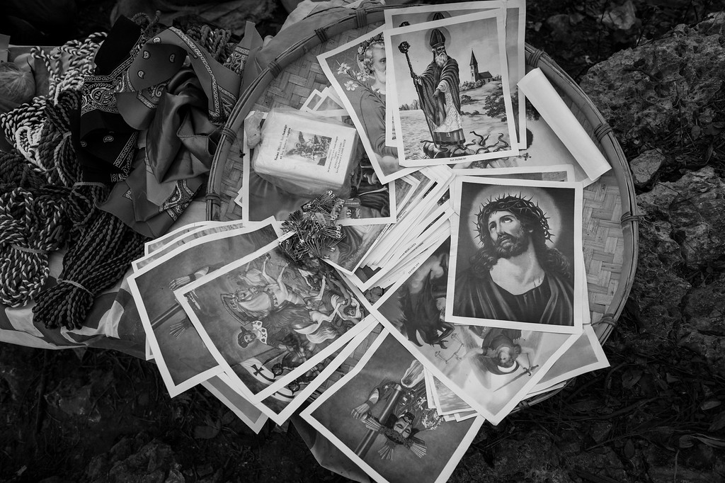 Prayer cards depicting various Christian saints serve as a portable connection to the divine, so that the worshiper may hold their energy within.