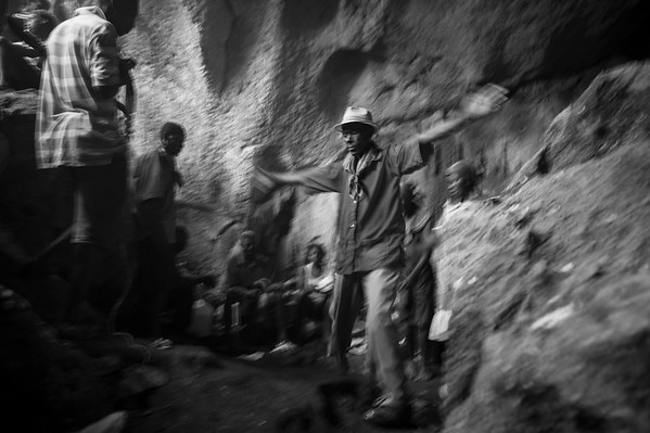 A Houngan begins to invoke the spirits  Lwa during the feast day of St. Francis De Assisi in a remote region of Haiti.