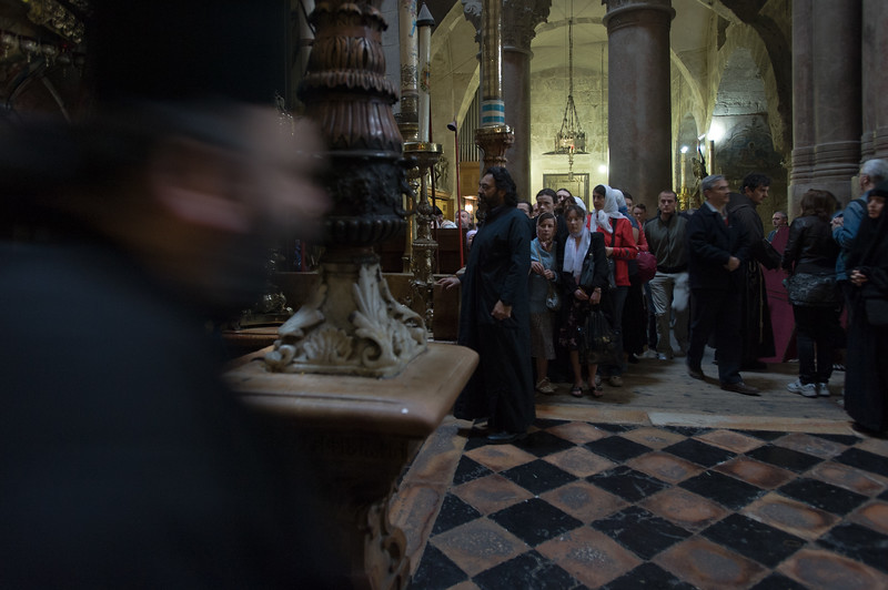 Jerusalem. Pilgrims gather around the 'Edicule of the Tomb of Jesus Christ' in The Church of the Holy Sepulchre, also known as the Basilica of the Resurrection. <br /> <br /> Christians traditionally believe the church is built on the site where Jesus was crucified, buried and resurrected.