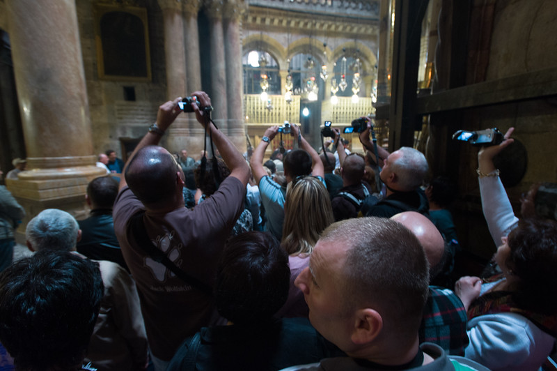 Jerusalem. Pilgrims attempt to capture footage of a blessing, which is taking place outside of the 'Edicule of the Tomb of Jesus Christ' in The Church of the Holy Sepulchre, also known as the Basilica of the Resurrection. <br /> <br /> Christians traditionally believe the church is built on the site where Jesus was crucified, buried and resurrected.