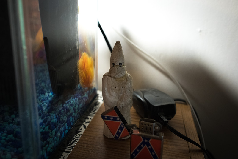"11/24/2018. Kentucky. USA. A six-inch vintage robed Klansman figurine made of plaster at the home of an Imperial Wizard. <br /> <br /> The Imperial Wizard, whose power is supreme ""within the limits of this Constitution"" and whose edicts, decisions and rulings were binding on all members of the order."""