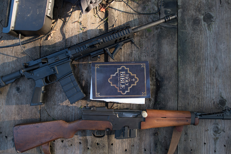 11/24/2018. Kentucky. USA. The King James Version of the Bible, along with two semi-automatic weapons sits atop a makeshift altar.