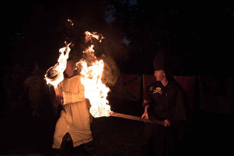 "As the Knighthawk (right) ignites the torch of each man, woman or child he asks ""do you accept this light"" (or ""do you accept the light of Christ""), the Klansperson responds ""I do"" and this starts the beginning of the cross lighting ceremony."