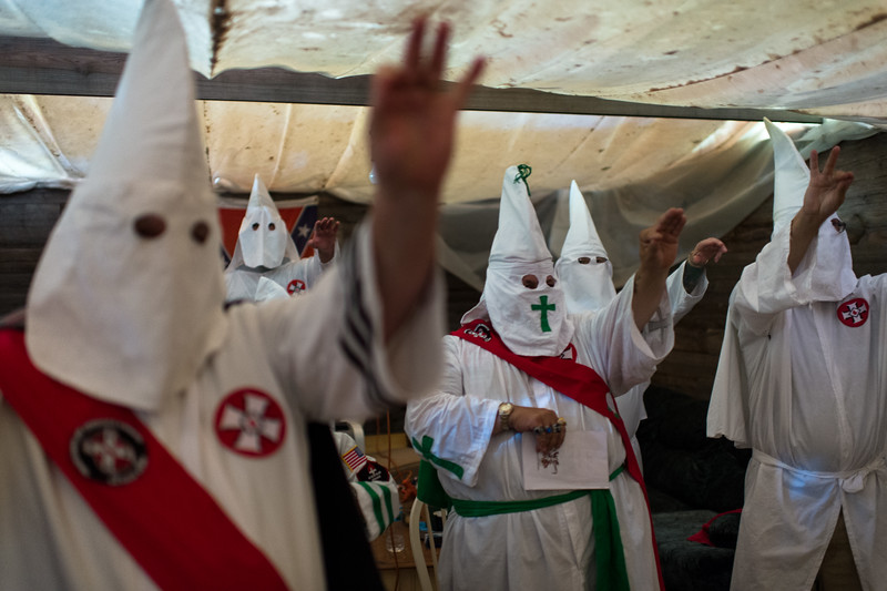 Klansmen/women during a Klonkave (secret meeting) of the Traditionalist American Knights of the Ku Klux Klan. Missouri.