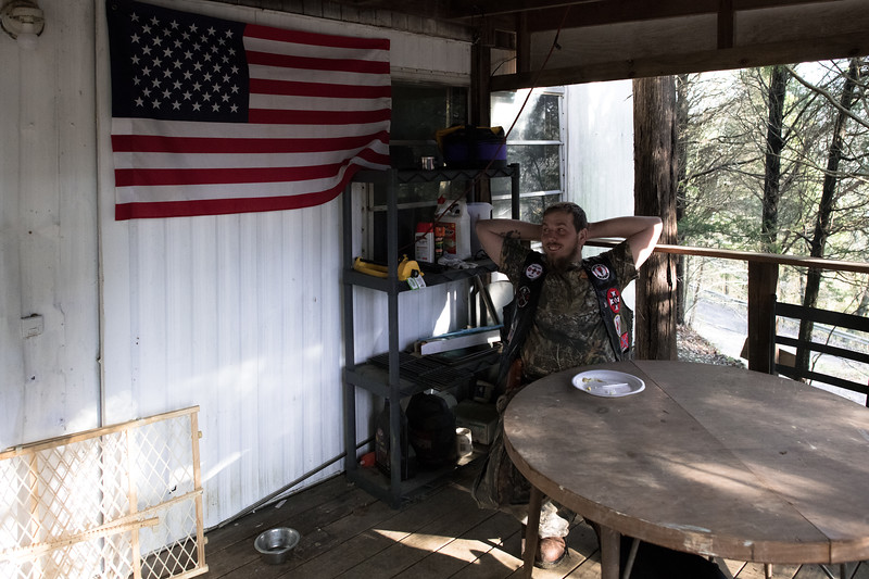 11/24/2018. Kentucky. USA. A Klansman, who also happens to be the Imperial klaliff/knighthawk takes a break after a turkey dinner in honor of Thanksgiving and the 103rd anniversary of the Klan's second era.<br /> <br /> On Thanksgiving night, November 25, 1915, sixteen men wearing white robes and hoods climb Stone Mountain in Georgia – a massive flat-topped outcropping of granite and quartz, 1,686 feet tall, located 15 miles east of Atlanta, now the scene of a massive carving honoring the Confederacy. Once at the peak, the men, led by William Joseph Simmons, hoist and burn a wooden cross. With this act, the Knights of the Ku Klux Klan is reborn.<br /> <br /> Five years later, the Invisible Empire reached Indiana.