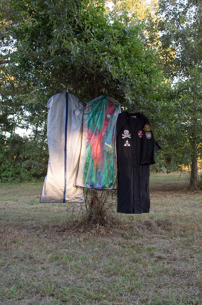 Klan robes hang from a tree at Klan rally hosted by the Bayou Knights of the Ku Klux Klan.