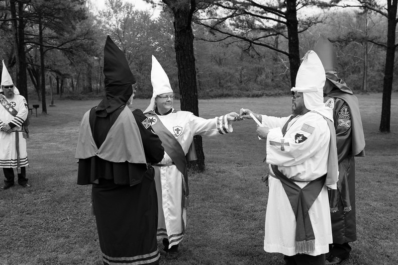 A couple exchange wedding bands during a traditional Klan wedding hosted by the Traditional American Knights of the Ku Klux Klan.