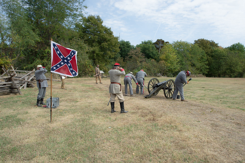 Two Klansman partake in a civil war reenactment. Missouri.