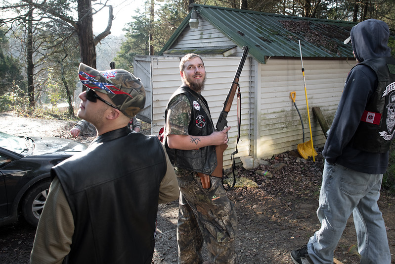 11/24/2018. Kentucky. USA. Members of a mid-Western Klan realm begin to show up at the home of their Imperial Wizard (leader) for a year-end gathering.<br /> <br /> This gathering was in tribute to November 25th, 1915 the day the 2nd era of the Klan was born.<br /> <br /> On Thanksgiving night, November 25, 1915, sixteen men wearing white robes and hoods climb Stone Mountain in Georgia – a massive flat-topped outcropping of granite and quartz, 1,686 feet tall, located 15 miles east of Atlanta, now the scene of a massive carving honoring the Confederacy. Once at the peak, the men, led by William Joseph Simmons, hoist and burn a wooden cross. With this act, the Knights of the Ku Klux Klan is reborn.<br /> <br /> Five years later, the Invisible Empire reached Indiana.