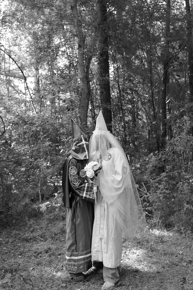 A Ku Klux Klan wedding ceremony in Walker, La., on August 30, 2008. The couple were wed by a Chaplin Klan member, where vows and custom Klan rings were exchanged during a cross lighting. This second cross lighting took place immediately following a group cross lighting ceremony - signifying the light of Christ and also meant to bring spiritual truth to a world that is blinded by misinformation and darkness.