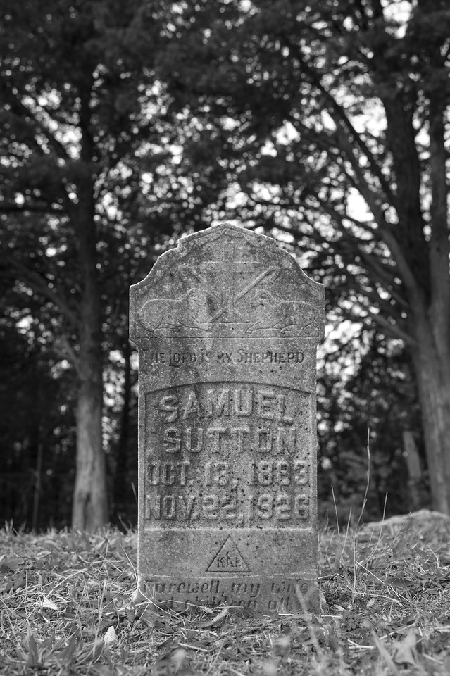 "The gravestone of KKK member Samuel Sutton. The bottom reads ""Farwell my wife and children, all my love."" Nov. 22nd, 1926."