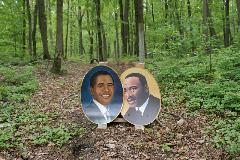 5/20/2017. Unknown location, Pennsylvania. USA. Posters of President Barack Obama and civil rights leader Martin Luther King Jr. used for target practice during a Ku Klux Klan gathering.