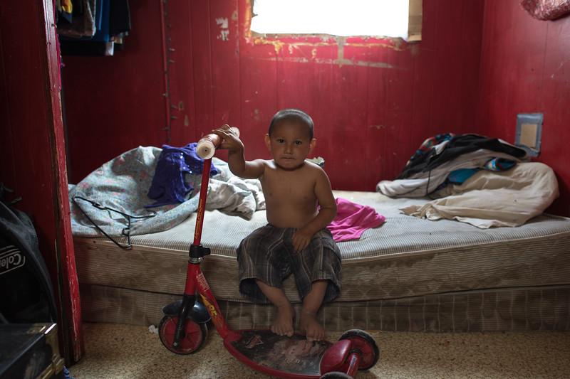 Little Alfie in his sister's room.<br /> Pine Ridge, South Dakota.