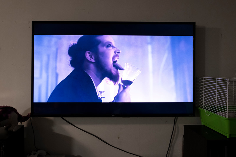 """Undisclosed location. South Carolina. The music video """"Killers With The Cross"""" performed by the German power metal band Powerwolf plays in the TV room of a Satanist on Halloween."""