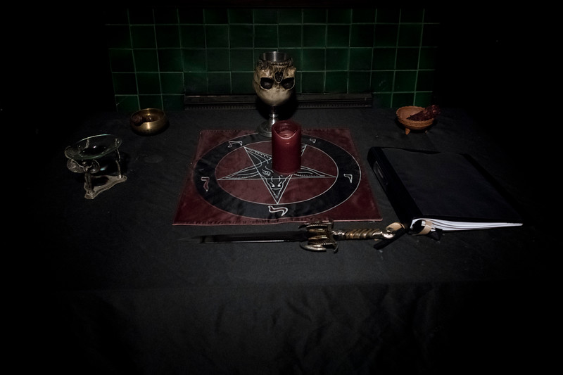 Undisclosed location. South Carolina. A Satanic altar in preparation for the ritual of ordainment. A lone candle either black or sometimes red is used to give the new Satanic priest a feeling of the Flames of Hell as he receives his vows of Priesthood.