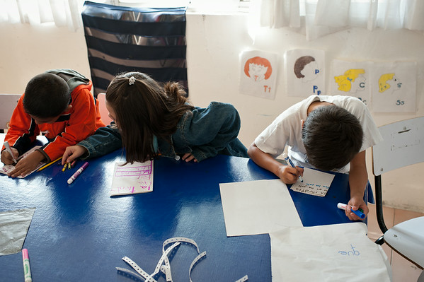 Speech pathologists at this camp in Mexico City use various methods of stimulation to assist in speech development. Children in the class are learning the relation between certain words and annunciation.