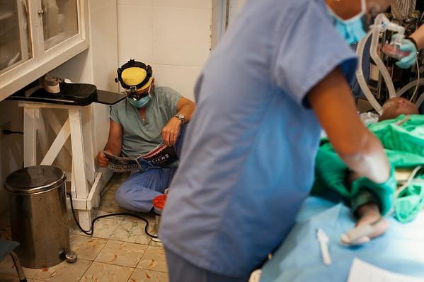 Dr. Larry Hollier, a volunteer surgeon from the Texas Children's Hospital, taking a short break between surgeries.